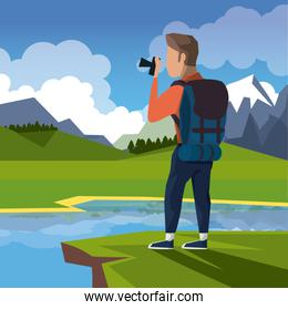 colorful landscape of hiking man taking a picture in cliff next to river