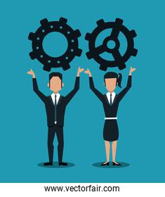 Business couple holding gears
