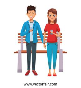Couple using smartphones on bench