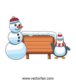 snowman and penguin with blank wooden sign