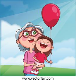 grandmother and granddaughter balloon outdoors