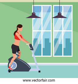 woman working out on gym machine