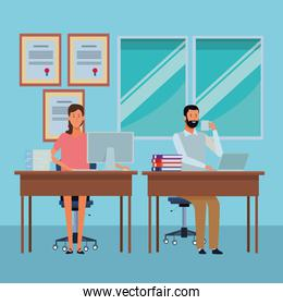 couple in a office desk