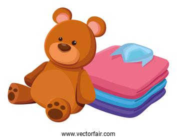 teddy bear toy and folded clothes