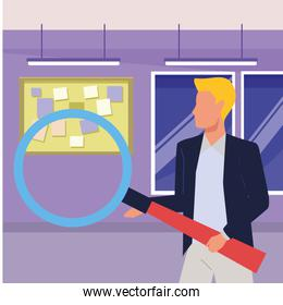 Executive businessman holding magnifying glass