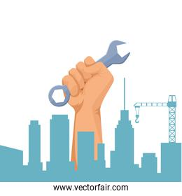 Construction worker hand holding tool