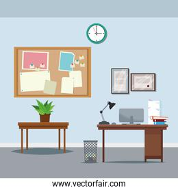 office workspace desk table potted plant clock notice board trash can laptop
