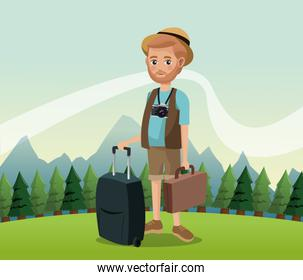 man bearded with camera suitcase baggage hat landscape background