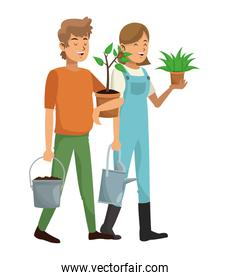 gardeners couple plant pot water can