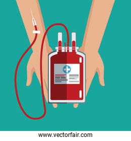hand holding iv bag blood care