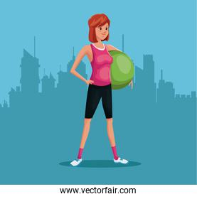woman sports training fitball urban background