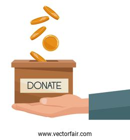 coins depositing in a carton box with banner of text donate on a hand