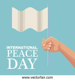 color poster hand holding a white flag waving international peace day text