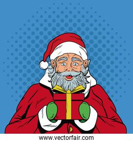 Santa claus with gift box in pop art