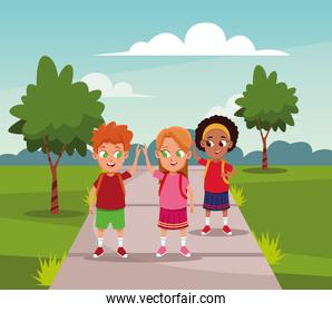 School kids with backpack at park