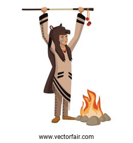 American indian with bear skin and bonfire