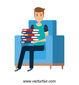 young man with books at the sofa