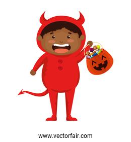 boy dressed up as a halloween devil with candies
