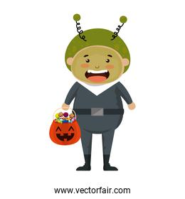 boy dressed up as a halloween martian with candies
