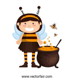 girl dressed up as a halloween bee with cauldron