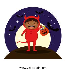 boy dressed up as a halloween devil on night