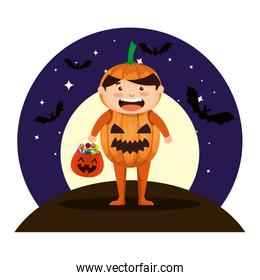 boy dressed up as a halloween pumpkin with bats flying