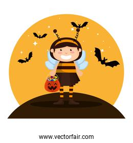 girl dressed up as a halloween bee with bats flying
