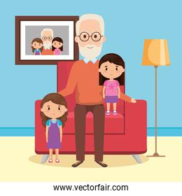 grandfather with granddaughters on livingroom scene