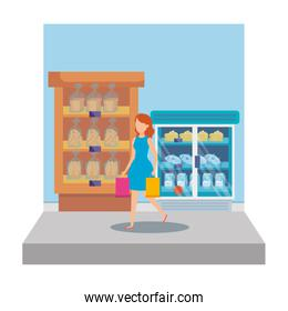 woman in supermarket shelving with bread bags