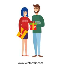 young couple with winter clothes and gifts