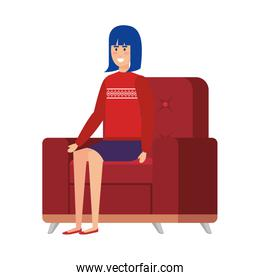 woman with christmas sweater sitting in sofa