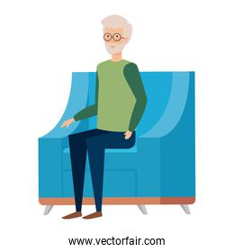 grandfather sitting in sofa with christmas clothes