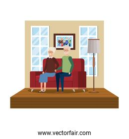 grandparents sitting in sofa with winter clothes