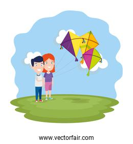 kids couple with kite flying in the field