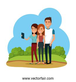 group of smiling young people using smartphone in the park