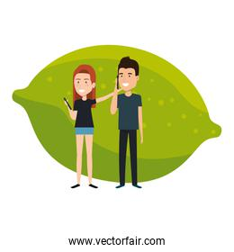 young couple with lemon fruit