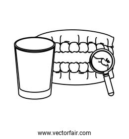 human teeth with water glass and magnifying glass