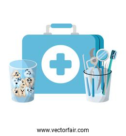 teeth in glass with medical kit and dentist tools
