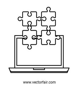 laptop with puzzle pieces