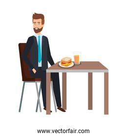 young businessman eating in table