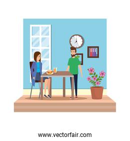 young couple eating in diningroom