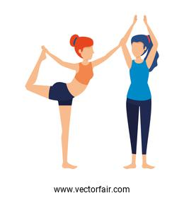 group of women practicing yoga position