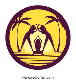 silhouettes of women practicing yoga position on the beach