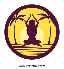 silhouette of woman practicing yoga position on the beach