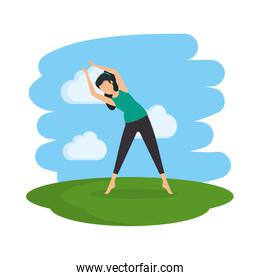 woman practicing yoga position in the field