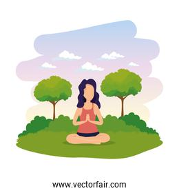 woman practicing lotus yoga position in the field
