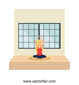 woman practicing lotus yoga position in the floor