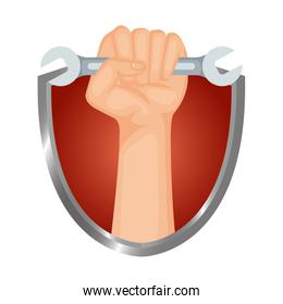 hand with wrench key in shield