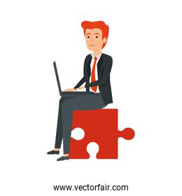 young businessman sitting in puzzle piece