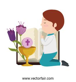 boy kneeling with book and chalice first communion